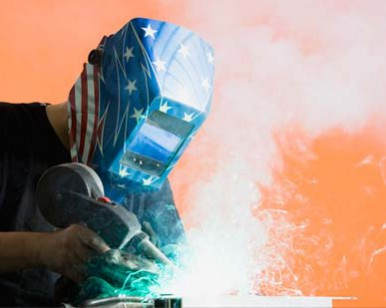 Man using a welding torch.